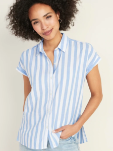 Woman wearing a blue and white striped collared blouse